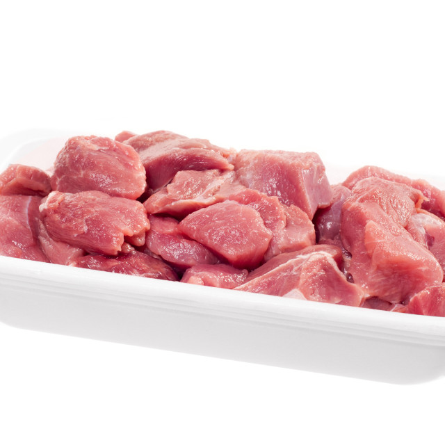 """""""raw red meat chopped for stew in white tray"""" stock image"""
