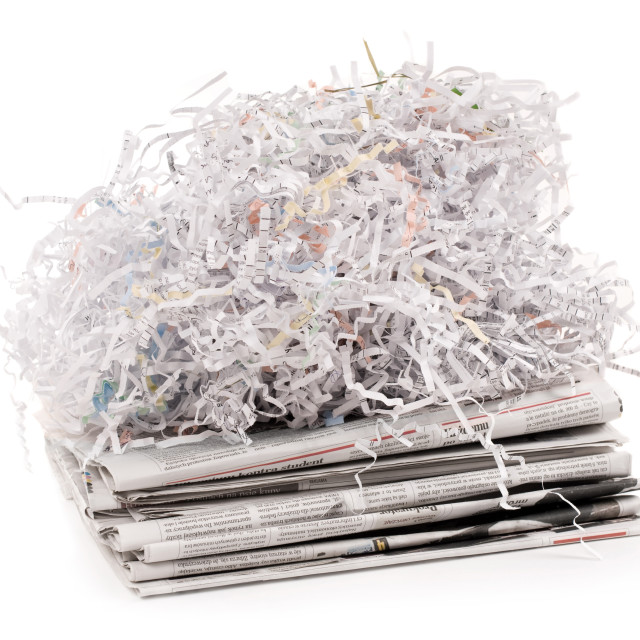 """paper shred on newspaper"" stock image"