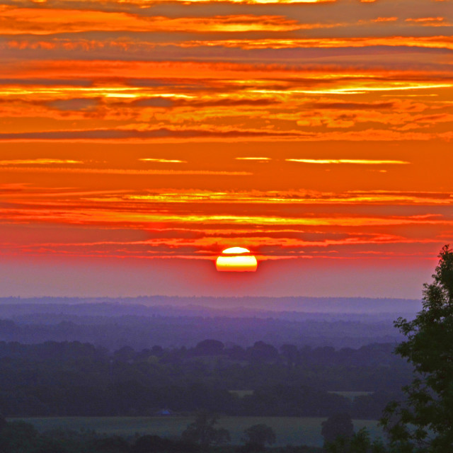 """""""Fire in the early morning sky"""" stock image"""