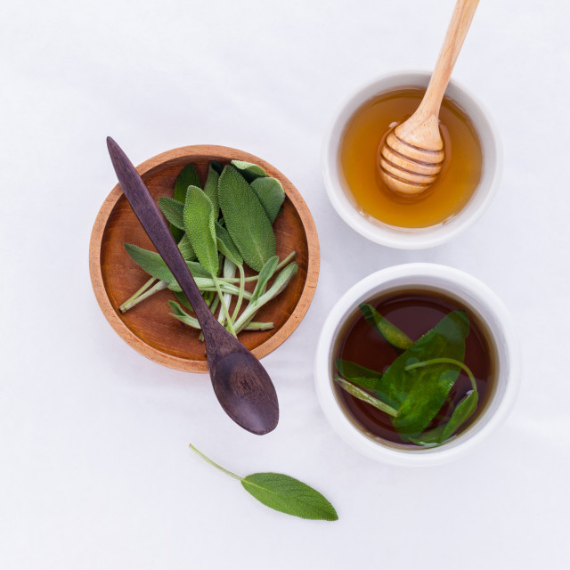 """""""The cup of sage healthy drinking tea for warm when illness and"""" stock image"""