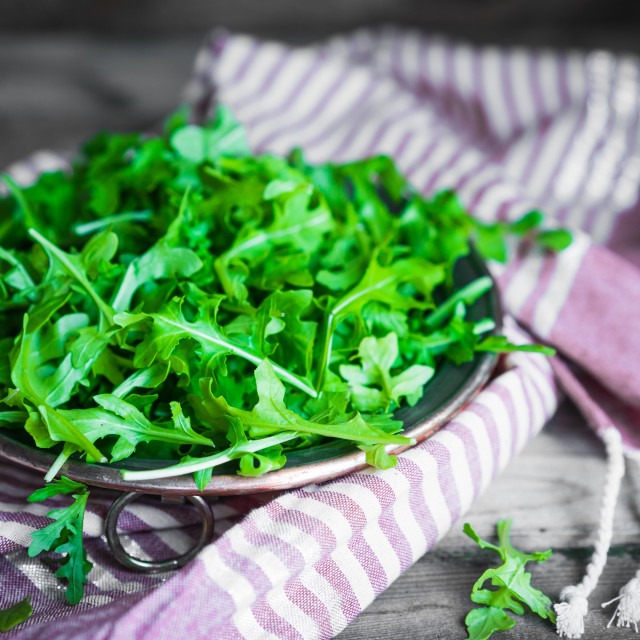 """""""Arugula salad on wooden background"""" stock image"""