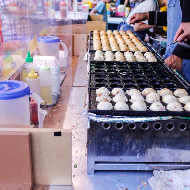 """Preparing steam buns at night market"" stock image"