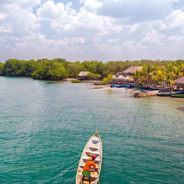 """""""Canoe Near the Coast"""" stock image"""