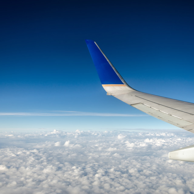 """Airplane Wing and Clouds"" stock image"