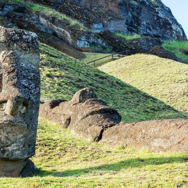 """Standing and Lying Moai Statues"" stock image"