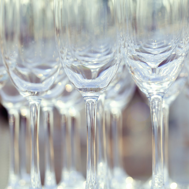"""Empty wine glasses setting for wedding party."" stock image"