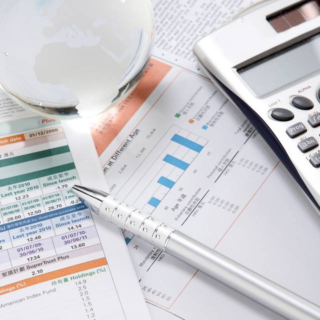 """financial charts and graphs on the table"" stock image"