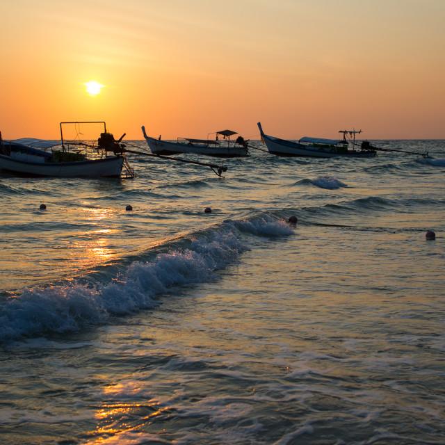 """""""Sunset Longboats"""" stock image"""