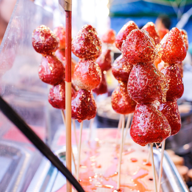 """Glazed strawberries at night market"" stock image"