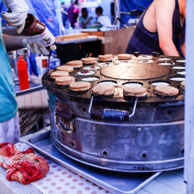 """Making cookies at the market"" stock image"