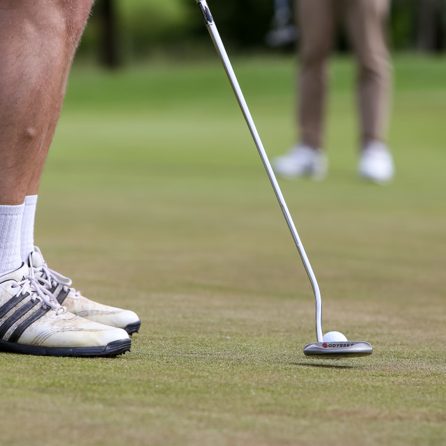 """""""Putting for the win"""" stock image"""