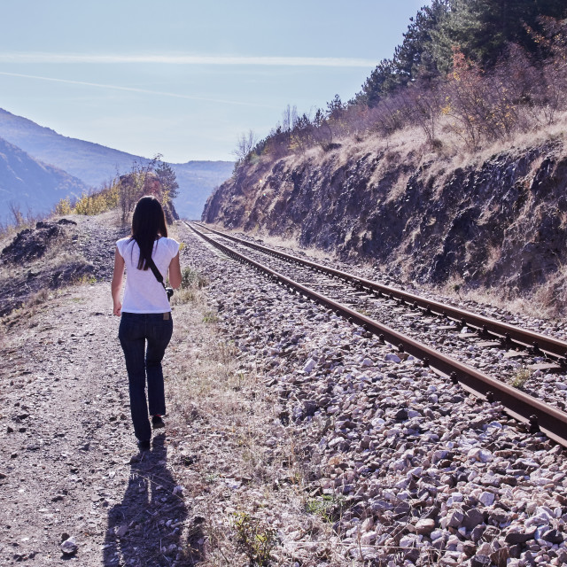 """Walking beside the train tracks"" stock image"