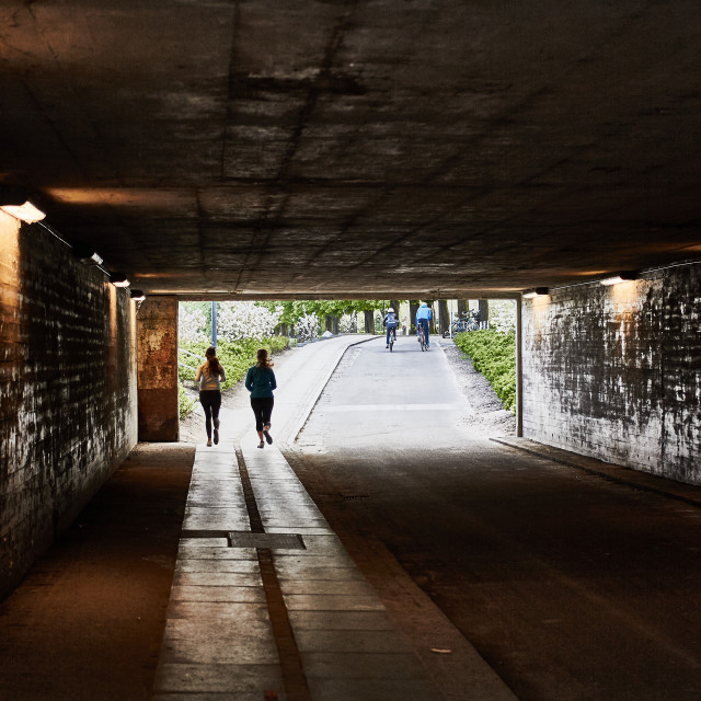 """Jogging through an underpass"" stock image"