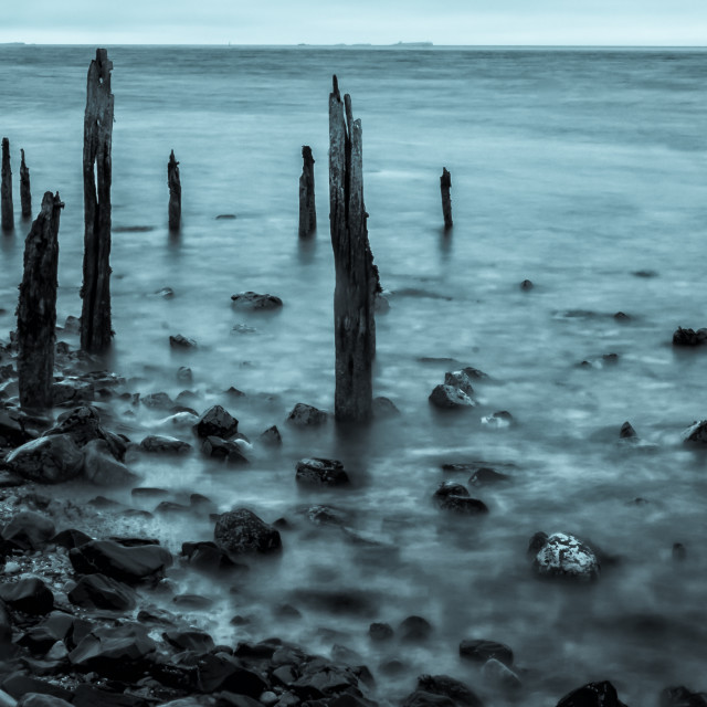 """""""Old posts at Lindisfarne in Cyan."""" stock image"""