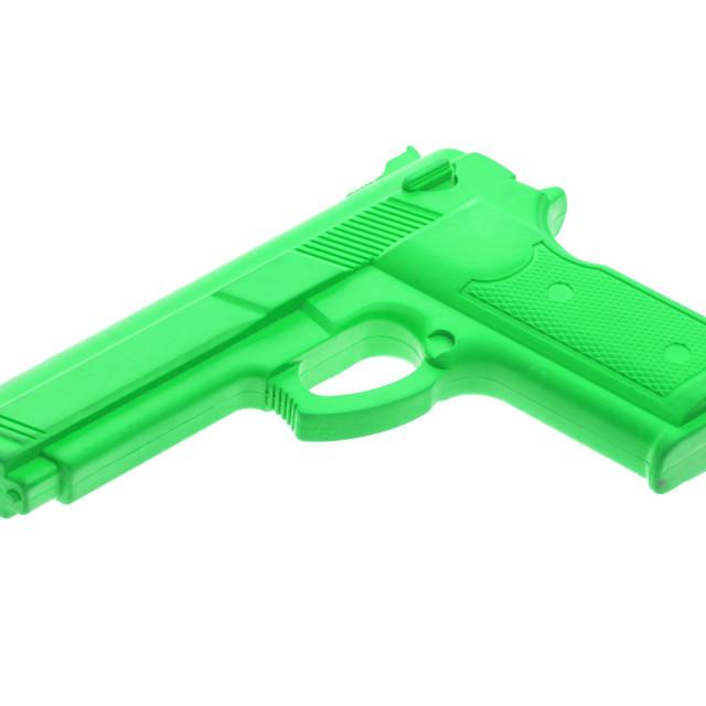 """Green training gun isolated on white"" stock image"