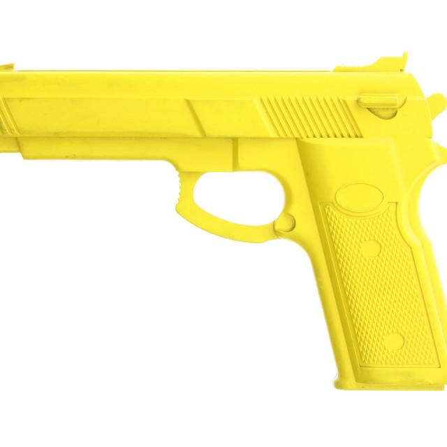"""Yellow training gun isolated on white"" stock image"