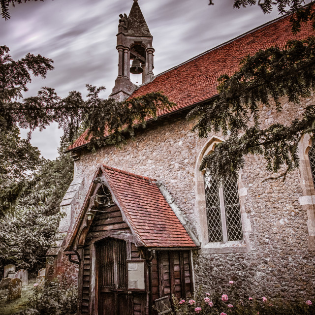 """Beaumont Church Hidden Behind Trees"" stock image"