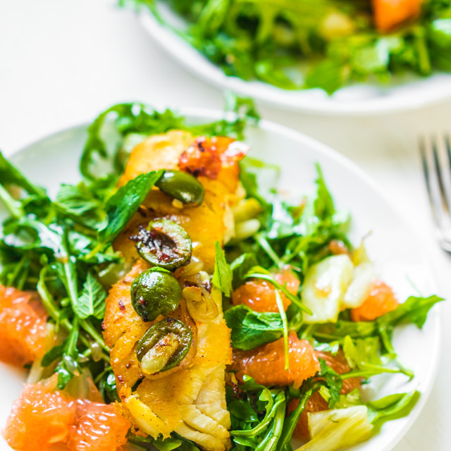 """""""Grilled fish with arugula salad"""" stock image"""