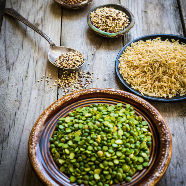 """""""Peas,brown rice,quinoa and buckwheat on wooden background"""" stock image"""