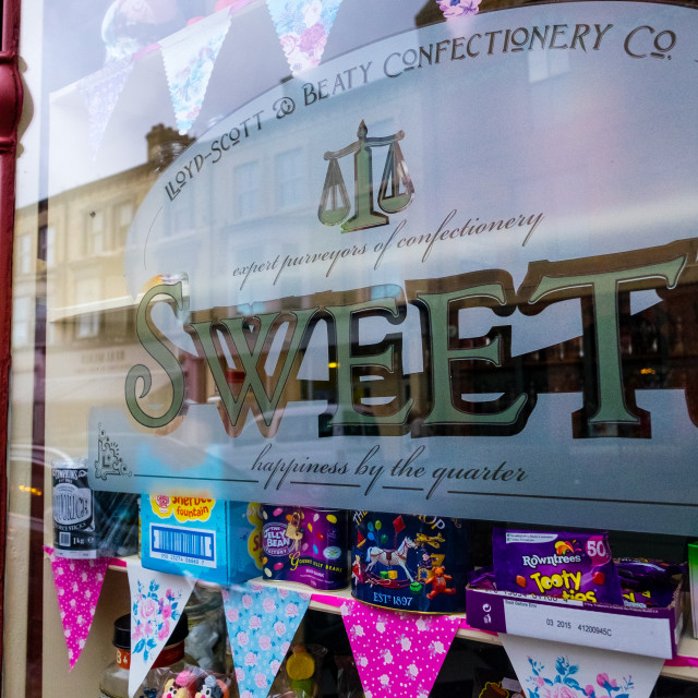 """Traditional sweet shop window (wide)."" stock image"