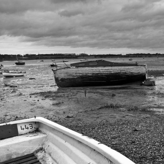 """Boats at low tide"" stock image"