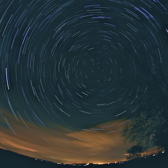 """Star Trails in the Night Sky"" stock image"