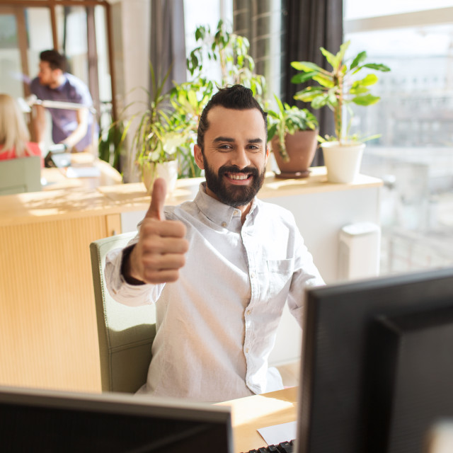 """""""happy male office worker showing thumbs up"""" stock image"""