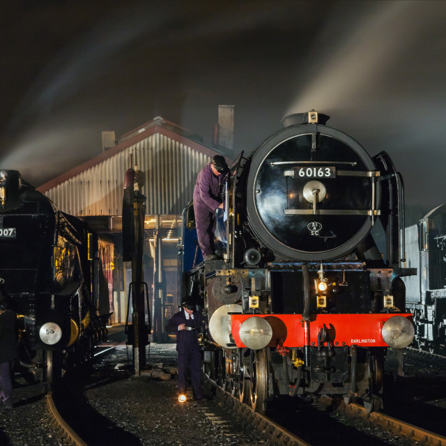 """Working on the engines by night"" stock image"