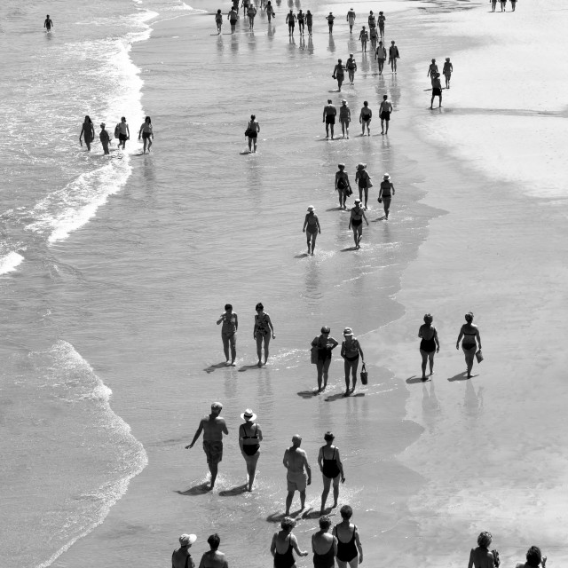 """Black & White Beach scene - people walking"" stock image"