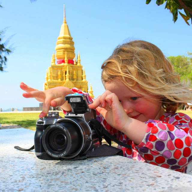 """Girl Taking Photograph on Holiday in Thailand"" stock image"