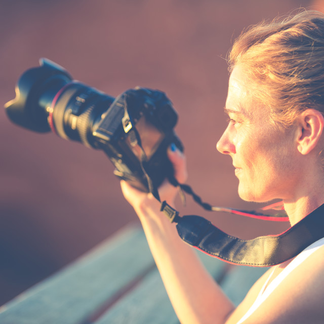 """Woman with camera"" stock image"