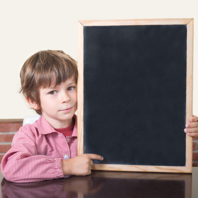 """school boy pointing blackboard"" stock image"