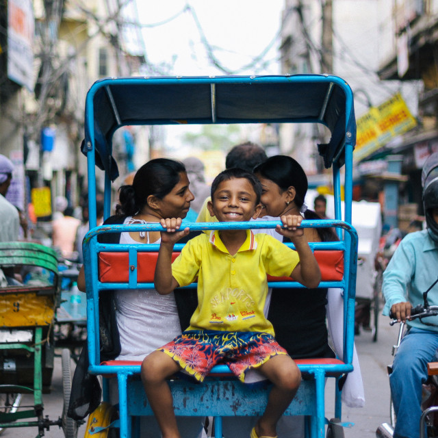 Child smiling on back of Richshaw