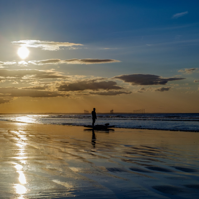 """Kayaker on the beach at sunset 1"" stock image"