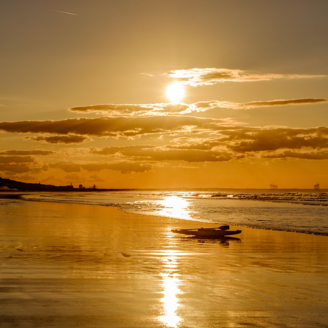 """Kayak on the beach at sunset 2"" stock image"