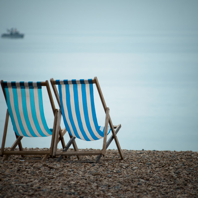 """Two Empty Deck Chairs on a Beach"" stock image"