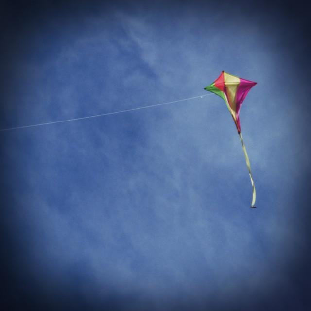 """""""Kite Flying against Blue Sky"""" stock image"""