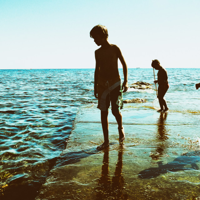 """Kids at the sea, Pantelleria"" stock image"