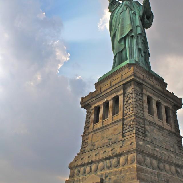 """Cloud Break over Statue of Liberty"" stock image"