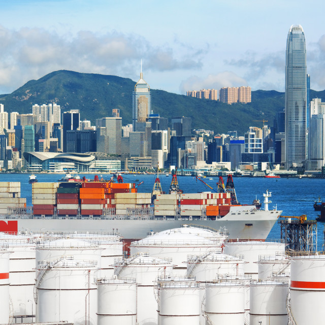 """Oil Storage tanks with urban background in Hong Kong"" stock image"