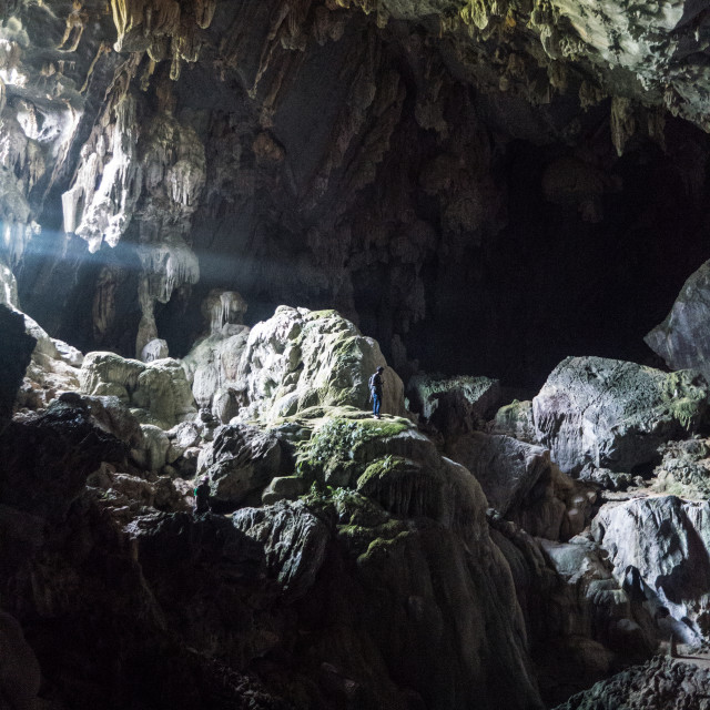 """Lone Man Standing in Huge Cave, Tham Phu Kham"" stock image"