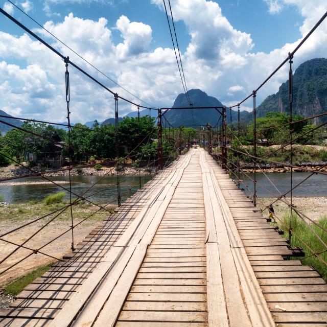 """Wood Suspension Bridge over River, Vang Vieng"" stock image"