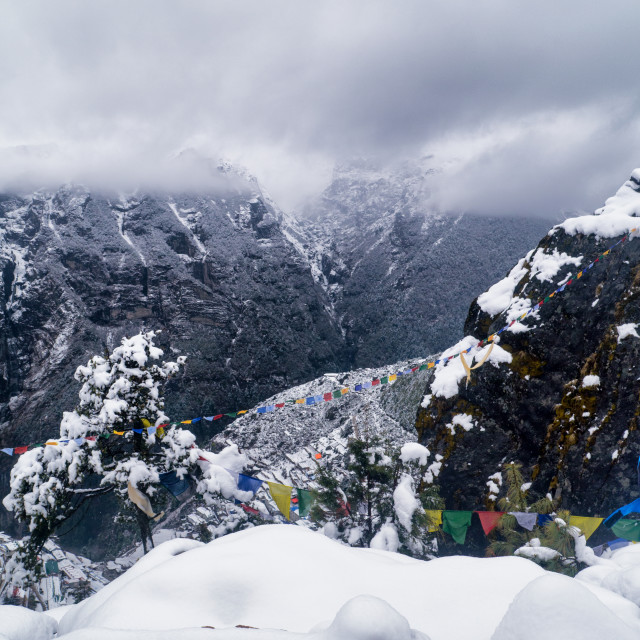 """Snow, Cloud & Prayer Flags in Himalayan Mountains"" stock image"