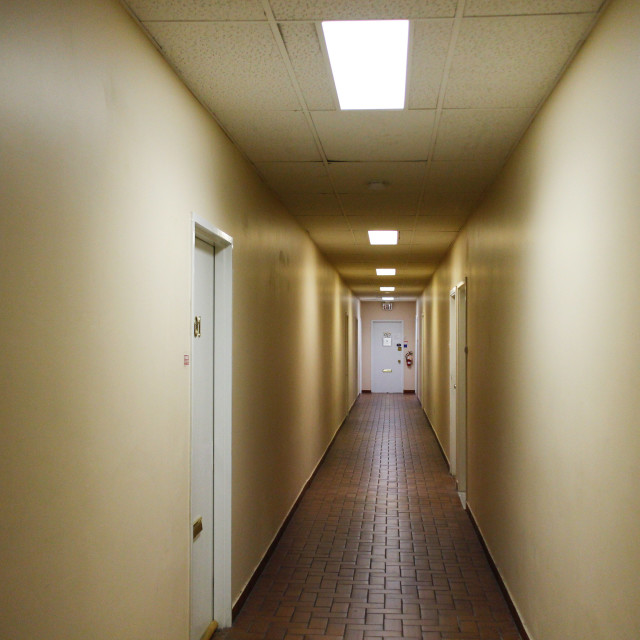 """Spooky hallway in old building"" stock image"