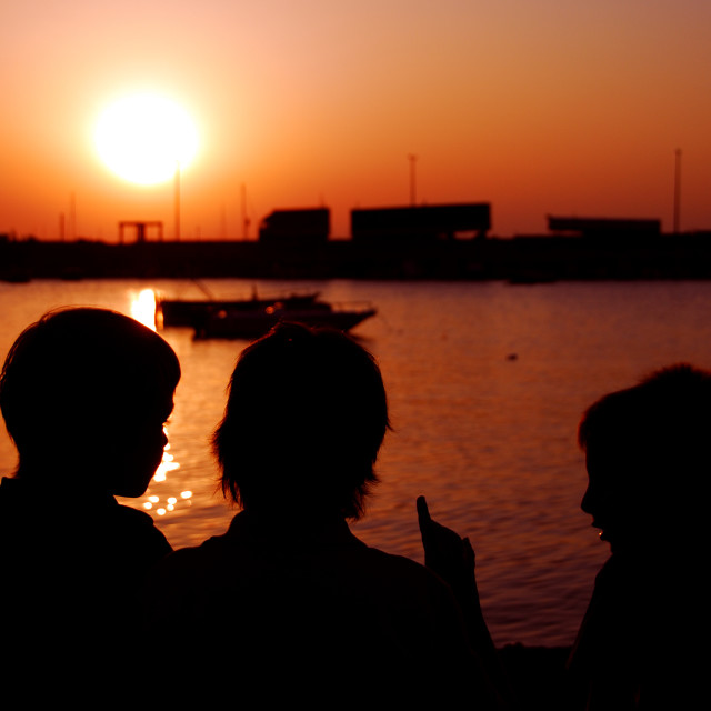 """Kids in the sunset"" stock image"