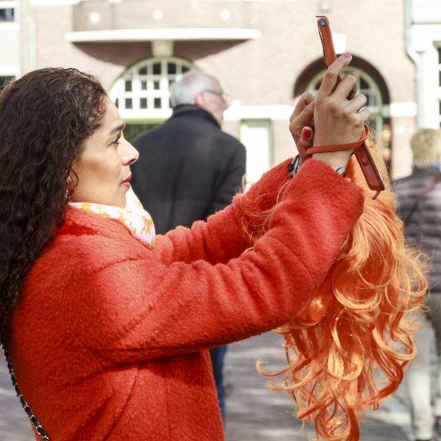 """Orange wig selfie"" stock image"