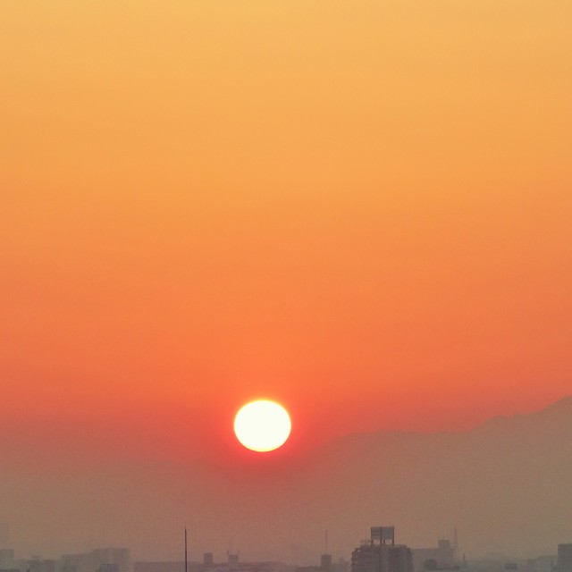 """Setting sun over Osaka"" stock image"