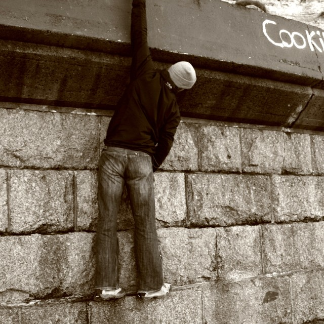 """""""Urban Sea Wall Climbing"""" stock image"""