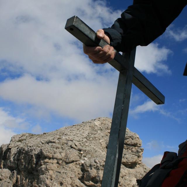 """Man Holding Cross Via Ferrata"" stock image"