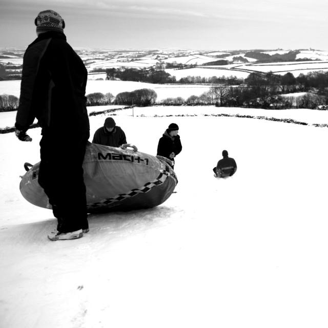 """""""Sledging in the snow in Devon"""" stock image"""